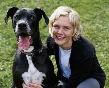 Large black dog with blonde owner
